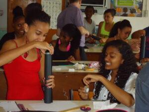School girls building telescopes