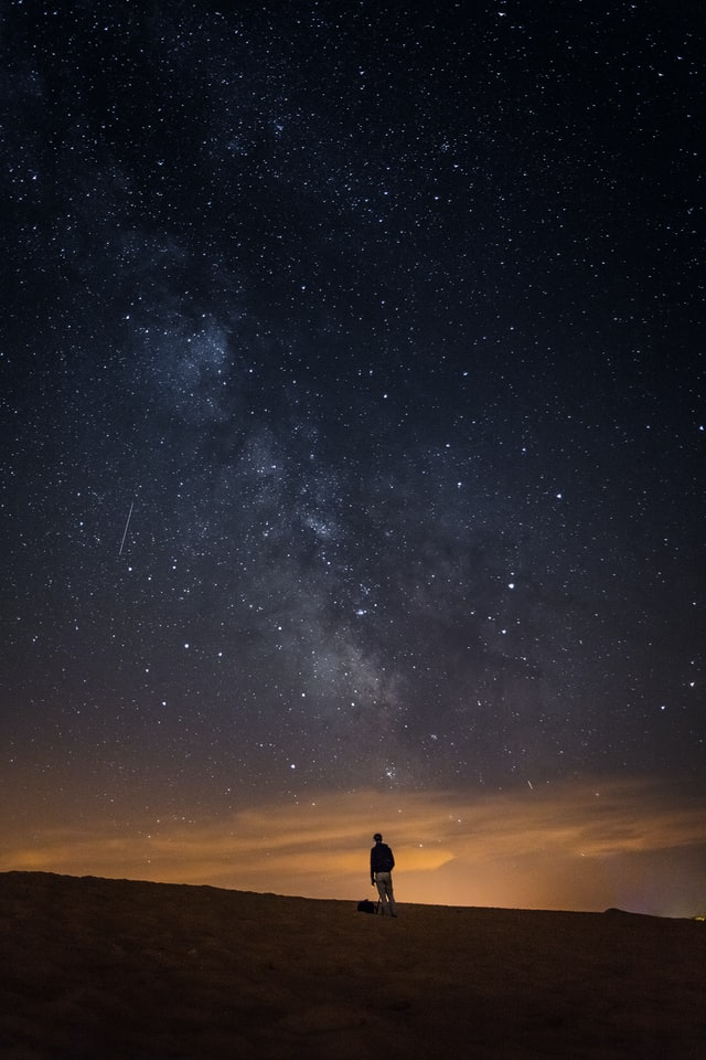 Person looking up at Milky Way