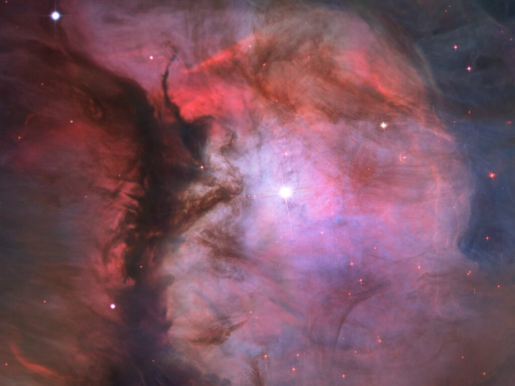 A massive star is illuminating this small region, called M43, and sculpting the landscape of dust and gas. Astronomers call the area a miniature Orion Nebula because of its small size and the single star that is shaping it. The Orion Nebula itself is much larger and has four hefty stars that are carving the dust-and-gas terrain.
